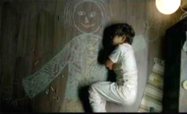 Orphan Boy Draws Mother Picture on Floor