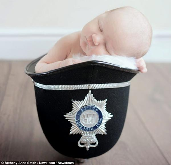 Policeman's Four-Day-Old Daughter Sleeping in His Helmet