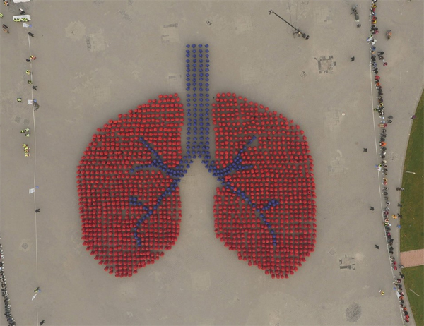 People Forming An Image Depicting Human Lung
