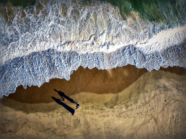 Perfectly-Timed Couple's Aerial Photo