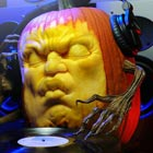 DJ Pump is an incredibly carved pumpkin sculpture by Andy Bergholtz. It was carved for the October 2012 cover page of Pacific San Diego Magazine. &#8220;The DJ pumpkin took...