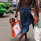 Father Carrying His Child in Bag
