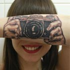 Optical Illusion with Camera-Inspired Tattoo