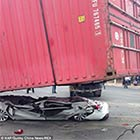 Crash Victims Survive After Car is Crushed Flat By Lorry's Shipping Container