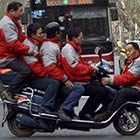 Five Men On An Electric Bicycle
