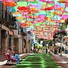 These beautiful and colorful umbrellas suspended from the mid air spotted by Flickr photographer Patricia Almeida during her visit to gueda (a Portuguese town) in the month of July....