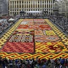 "Xinhua /Landov / Barcroft Media Brussel's Grand Place got so much attractions as volunteers constructed a huge ""Flower Carpet"" made up with about 600,000 flowers. This unique flower carpet..."