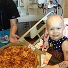 2-Year-Old Cancer Patient Gets Pizza Party When She Taped The Request On Her Window