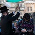 "The Kaparot (literally means ""atonement"") is a Jewish ritual takes place one day before Yom Kippur. The person swings a live chicken or a bundle of coins over one's..."