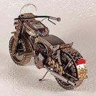 Ukranian artist Dmitry Khristenko creates incredible miniature replicas of motorcycles using components and parts from the old wristwatches. He also creates some other vehicles such as quad bikes, tricycles...