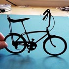 I have showcased paper-cut world maps silhouettes by Joe Bagley in the past and today its time to get inspiration from paper-cut bicycles he made.