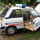 Police Car Transformed Into A Chicken Coop