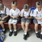 Quirky China News / Rex Features Six-year-old quadruplets have had numbers shaved into their hair before they start school for their first time. Their parents decided to mark them...
