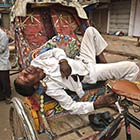Indian Rickshaw Puller Sleeps On His Rickshaw