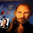 An artist gives finishing touches to a Rangoli depicting Steve Jobs in Mumbai. Rangoli, the Indian art of arranging finely ground colored powders, is part of Diwali, the festival...