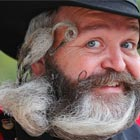 German hairdresser Elmar Weisser, 48, poses with his beard, which is shaped as a stork, during the 2012 European Beard and Mustache Championships.