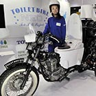 Japanese bathroom products maker Toto unveils the eco-friendly motorcycle Toilet Bike Neo, which uses bio-fuel from the discharges of livestocks or waste water, at the Eco Products exhibition in...