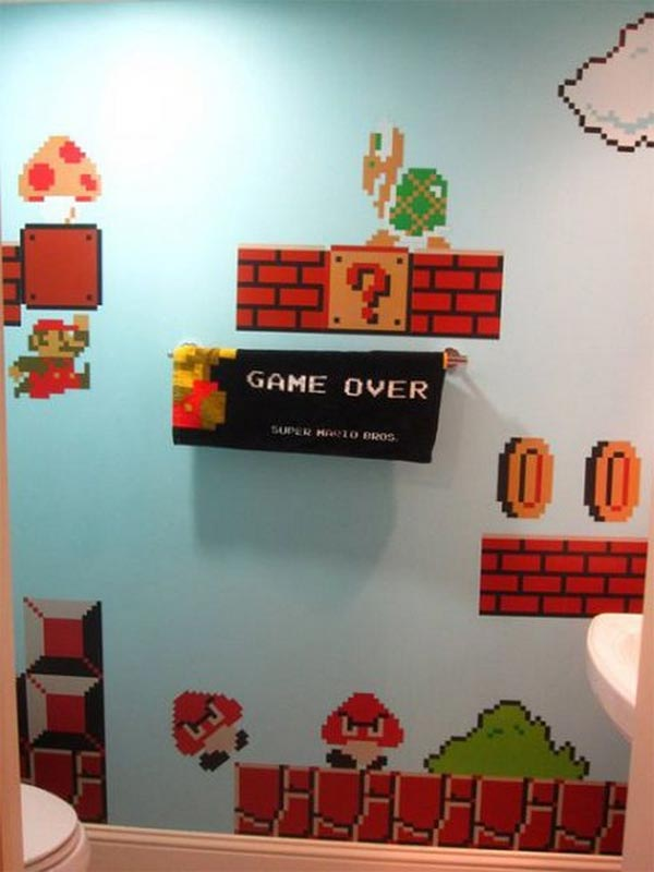 walls of toilet decorated with Super Mario theme