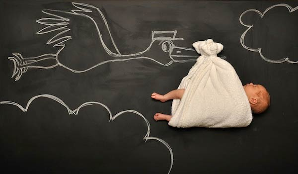 Mother Of Two Illustrates Babies' Dreams On Blackboard