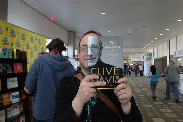 People Creatively Blend Themselves in with Book Covers