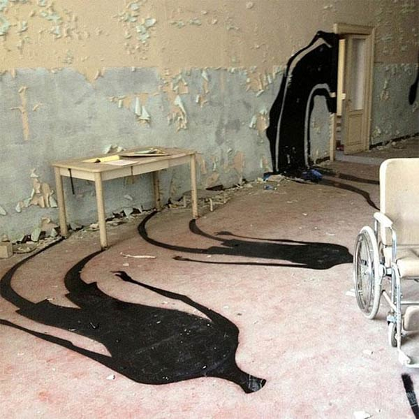 Street Artist Paints Ghostly Shadows in Mental Hospital