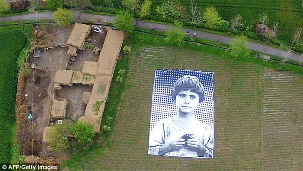 Giant Poster of Girl  Aims To Make Remote Aircraft Operators Think Before They Bomb