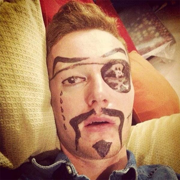 Pirate Face Drawn on Drunk Guy