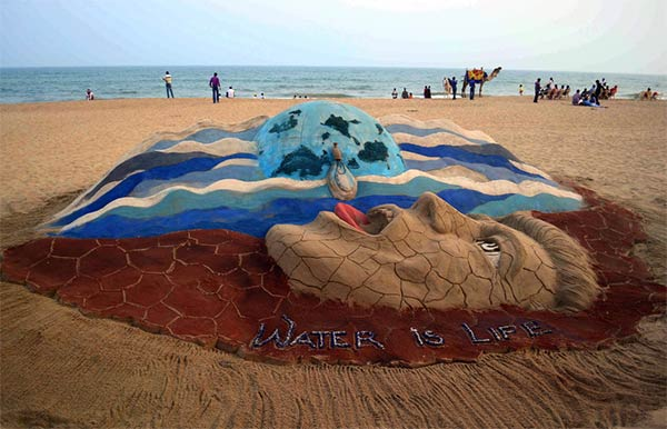 Water Day Sand Sculpture by Sudarshan Pattnaik