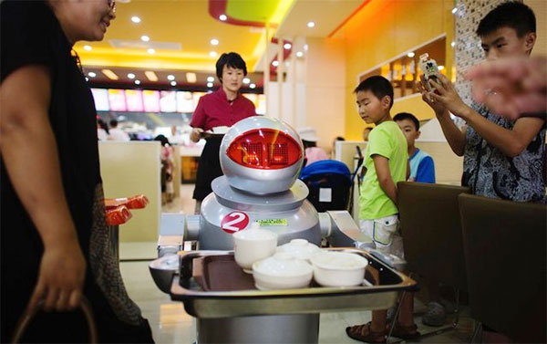 Customers in Restaurant Served By Robots