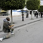 Tunisian Man Holds Back Riot Police with a Baguette