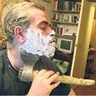 Man Shaving with Shovel, Hatchet or Scissors