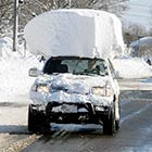 Lazy Driver Having Large Chunk of Snow On Its Top