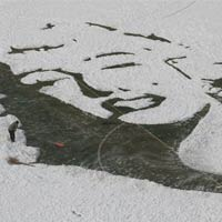 Marilyn Monroe Portrait Created with Snow On Soccer Pitch