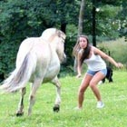 10 Funny Examples of Women Messing with Animals